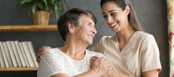 happy senior with caregiver
