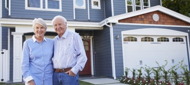 Senior couple hoping to age in place pose outside their home